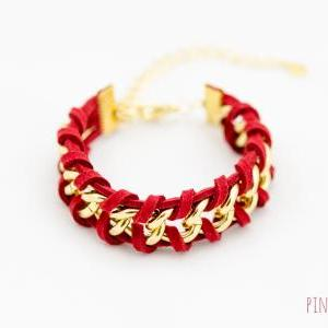 red woven chain bracelet , gold cha..